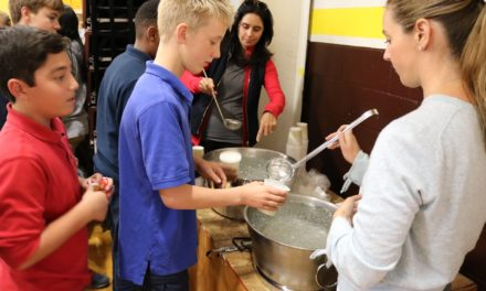Middle Schoolers learn how inequality leads to hunger in simulated experience